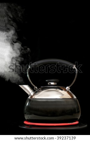 Tea kettle with boiling water on black background. Heater glow under the kettle. - stock photo