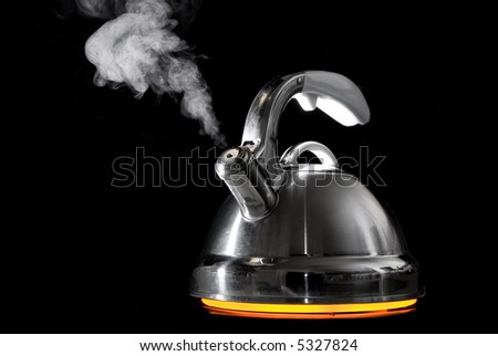 Tea kettle with boiling water on black background. Heater glow under the tea kettle. - stock photo