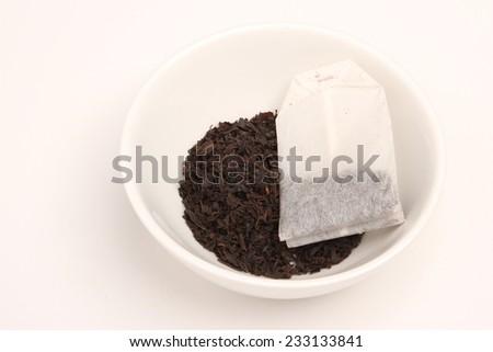 Tea leaves and tea bag  - stock photo