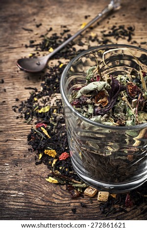 tea leaves scattered on the table in country style.Selective focus - stock photo
