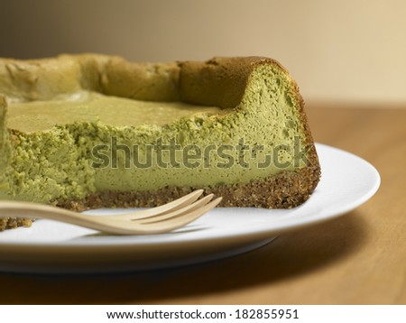 Tea Matcha cheese cake, on a wood background - stock photo