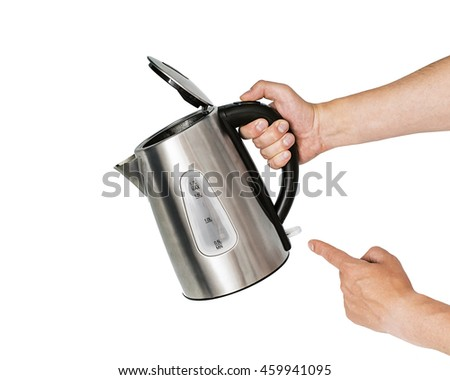 Tea metal kettle with boiling water in the kitchen close up, Women hand hold the iron electric kettle, preparing hot drink, click on the button - stock photo