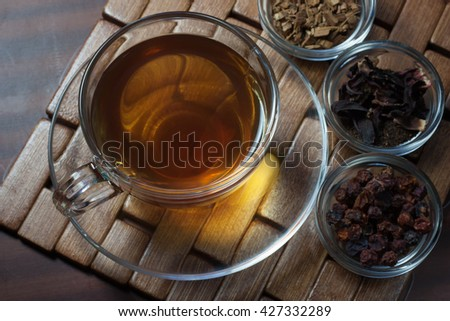 Tea on the wooden stand, rustic table.