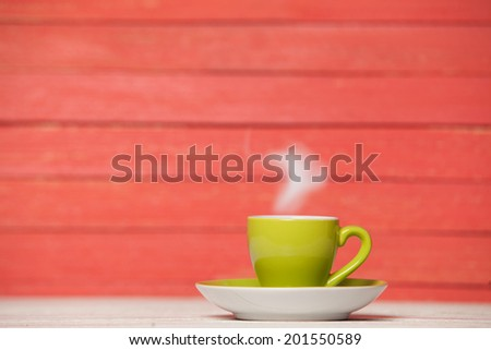Tea or coffee cup on wooden table. - stock photo