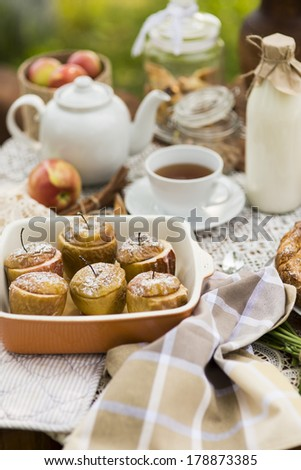 tea party with baked apples - stock photo