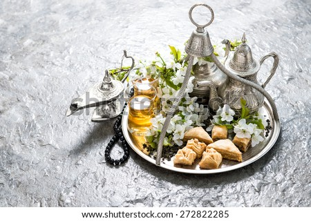 Tea pot and glasses, traditional oriental delight baklava. Islamic holidays decoration - stock photo