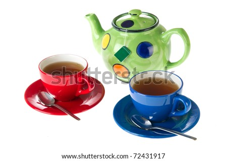 Tea pot with cups in red and blue