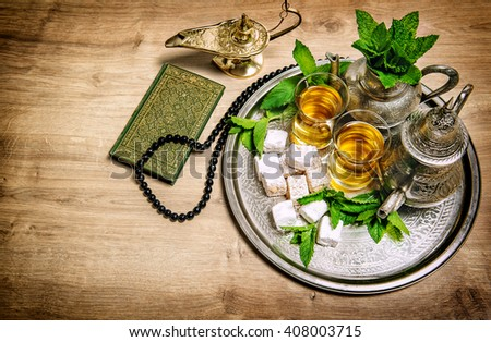 Tea pot with glasses. Oriental hospitality concept. Food and drink. Islamic holidays decoration. Vintage style toned picture - stock photo