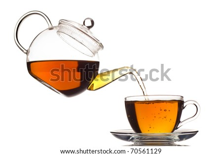 tea pouring in the cup isolated on white - stock photo