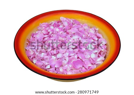 tea rose petals prepared for in the large enamel preserving pan before preserving confiture - stock photo
