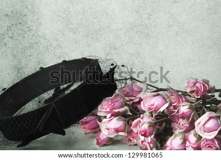 Tea roses and vintage hat with veil - stock photo