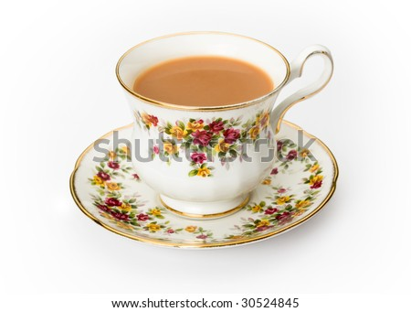 Tea served in a traditional English cup and saucer - stock photo