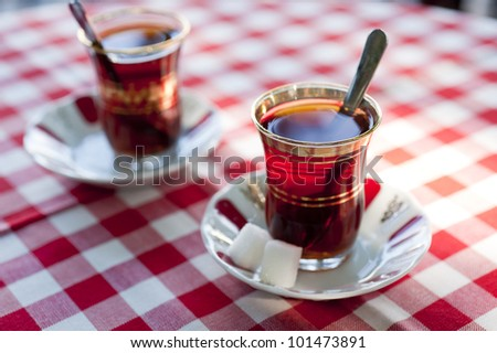 Tea served in traditional Turkish teacups - stock photo