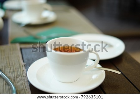 tea serves in a white cup and saucer.