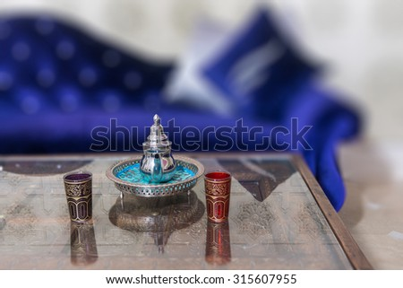 Tea service in a Moroccan style lounge - stock photo