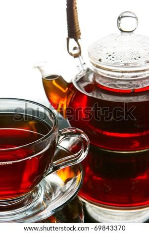 Tea service Teapot and cup of tea - stock photo
