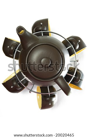 Tea service with one teapot and six dishes and cups, top view - stock photo
