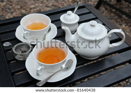 Tea Set on a Wooden Table - stock photo