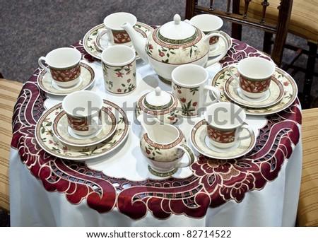 Tea set - pottery on table - stock photo