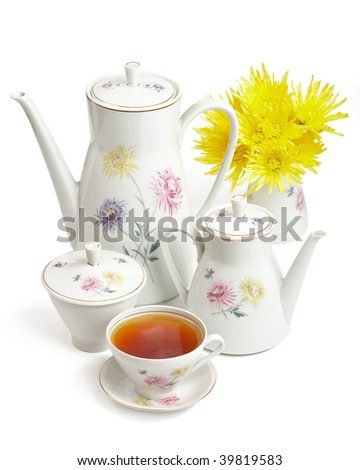 Tea set with flowers isolated on a white background - stock photo