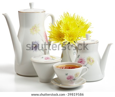 Tea set with flowers isolated on a white background