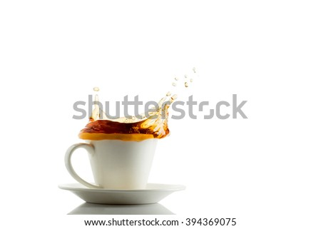 Tea splash out of cup isolated in white background