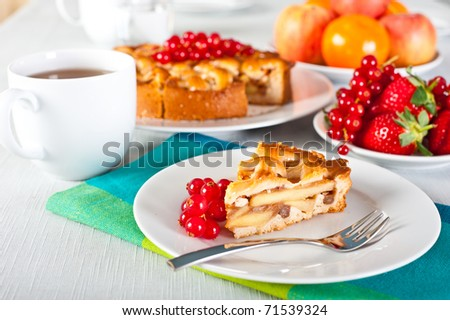 Tea table served with apple pie and fruits. - stock photo