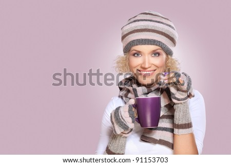 Tea time / Beautiful blond mid adult woman in winter clothes with cup of tea