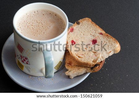 Tea time snacks, A cup of tea with cookies. bread and rusk