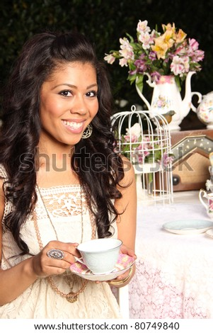Tea Time with a Young Woman - stock photo