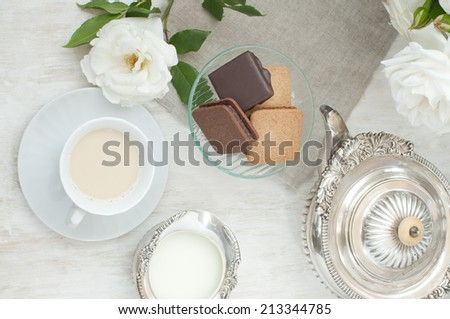 tea time with milk tea and biscuits  - stock photo