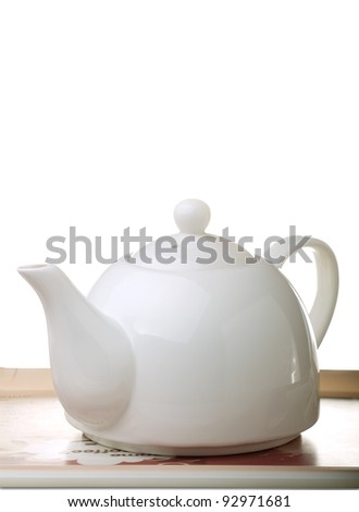 Tea tray with teapot isolated on white - stock photo