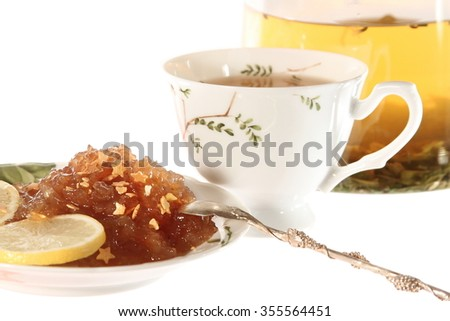 Tea with Apple marmalade or jam isolated on the white background