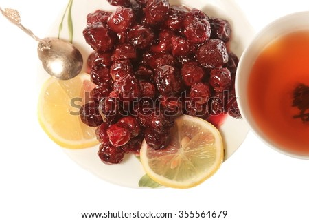 Tea with cherry jam and lemon isolated background flat
