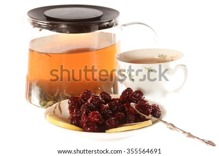 Tea with cherry jam and lemon isolated on the white background