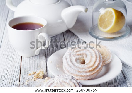 Tea with cookies on wooden background - stock photo