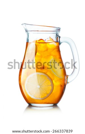 Tea with ice in a pitcher. Jug full of iced tea with lemon - stock photo