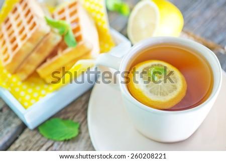 tea with lemon - stock photo