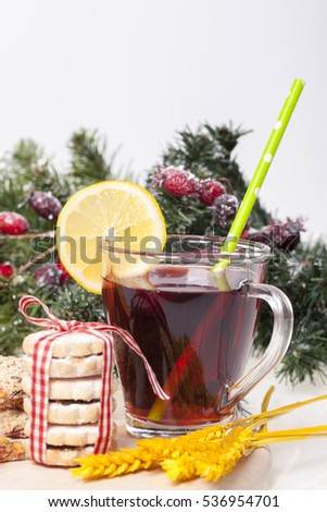 Tea with lemon and biscuits on a wooden base