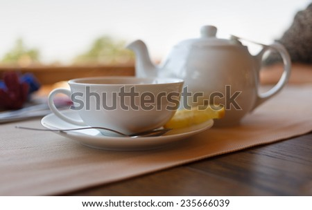 Tea with lemon and tea maker. Shallow depth of field. - stock photo
