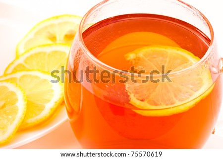 tea with lemon in a cup on a white background
