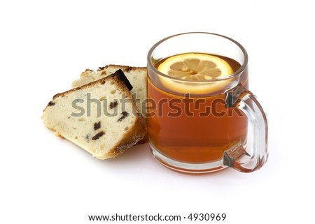 Tea with lemon in a transparent cup and two pieces of cake, isolated - stock photo