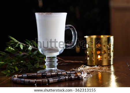 Tea with milk and cinnamon in a glass Cup