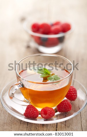 tea with mint and berry - stock photo