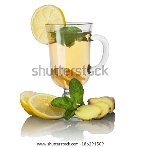 Tea with mint and lemon and ginger on white