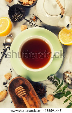 Tea with mint, ginger and lemon on rustic  background