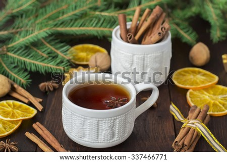 tea with spices in a ceramic cup with Christmas decorations - stock photo