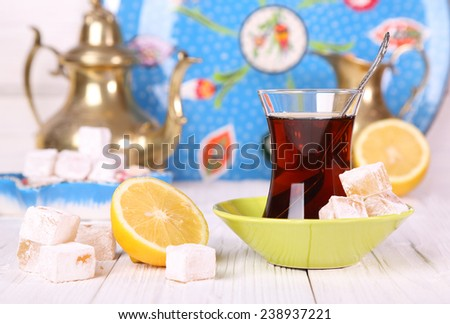 Tea with Turkish Delight and lemon on a white table