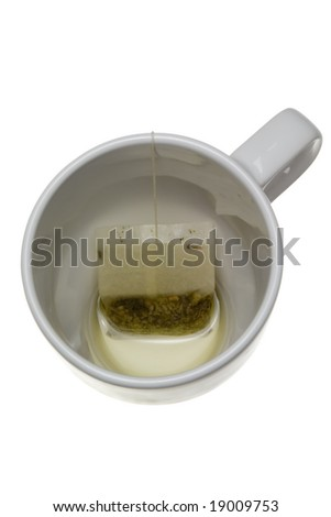 Teabag in an empty cup isolated on white background