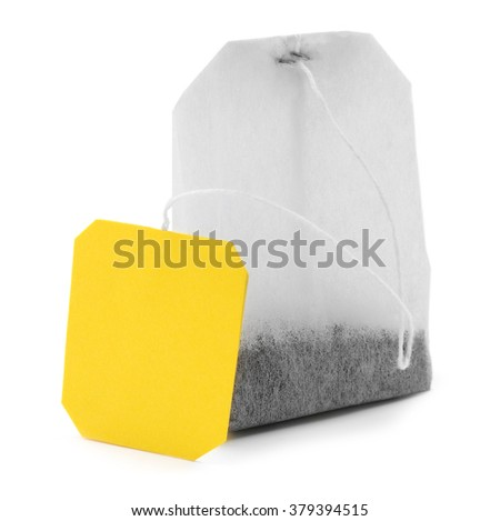 Teabag with yellow label isolated on white background - stock photo